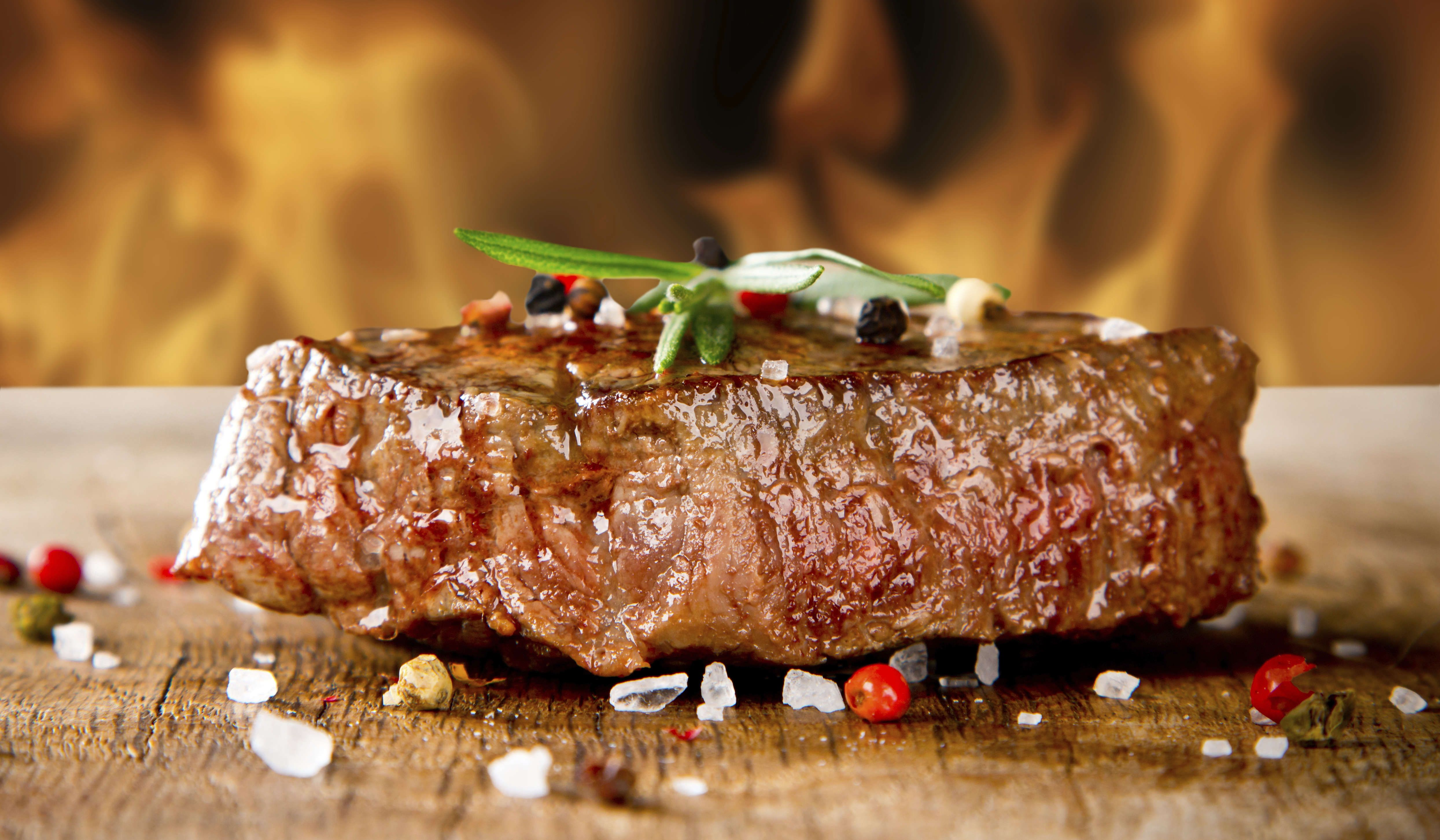 Delicious beef steak on grill
